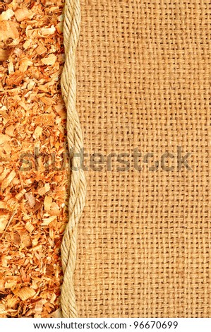 Sawdust flakes piled on logs of sack - stock photo