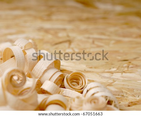 Sawdust on the plywood background - stock photo