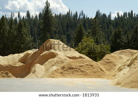 Sawdust piled up at a forest products sawmill. - stock photo