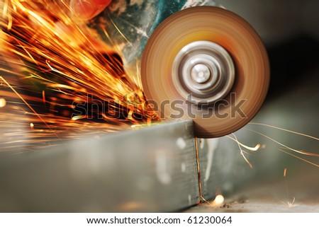 sawing metal - stock photo