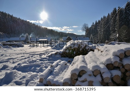 Sawmill and wood in winter. storage timber. forestry. woodcraft - stock photo