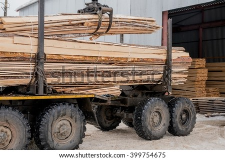 Sawmill. Image of truck transports boards - stock photo