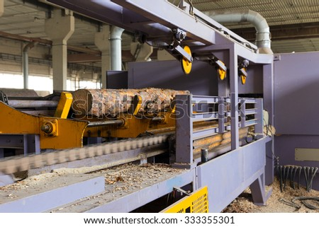 Sawmill. The process of cutting logs into boards - stock photo