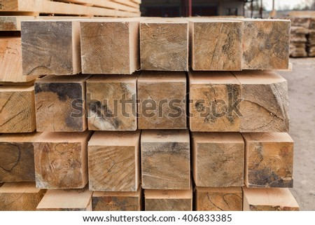 sawmill, wood processing, timber drying, timber harvesting, drying boards, baulk, work at the sawmill, dead trees, production, yellow wood is dried in a sawmill, wood processing plant  - stock photo