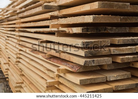 sawmill, wood processing, timber harvesting, drying boards, baulk, lumber-mill, wood products industry, production of forest products, enterprises for the primary processing of wood    - stock photo