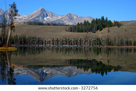 Sawtooth Mountains reflected in Little Redfish Lake, Stanley Idaho - stock photo