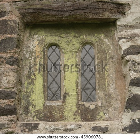 Saxon Window in St Bueno's Church on the South West Coast Path between Porlock Weir and Lynton at Culbone in Somerset, England, UK - stock photo