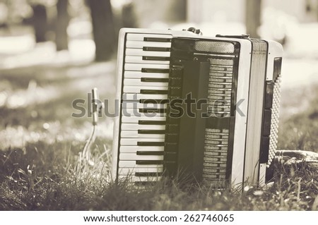 Saxophone and accordion in the nature - Retro style - stock photo