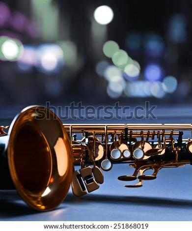 saxophone before a window in nightclub - stock photo