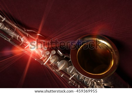 Saxophone close-up macro detail on burgundy background with light effect