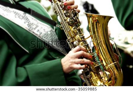 saxophone in marching band - stock photo