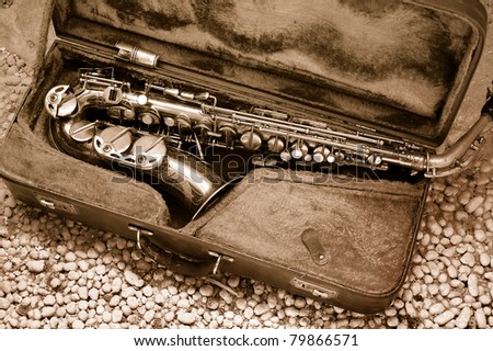 Saxophone in old leather case ? still life - stock photo