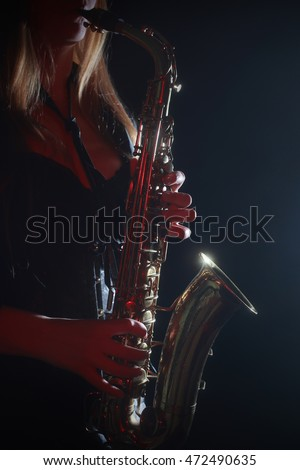 Saxophone Jazz Music Instrument. Saxophonist playing alto saxophone. Sax player hands close up