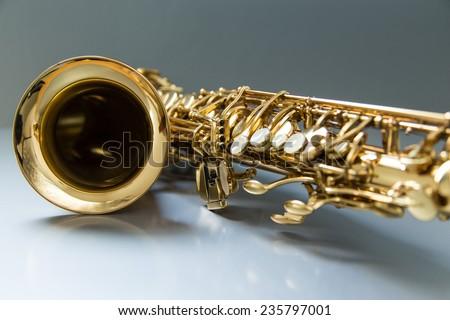 Saxophone on the gray background - stock photo