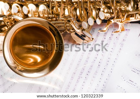 Saxophone on the printed music - stock photo