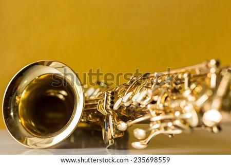 Saxophone on the yellow background - stock photo