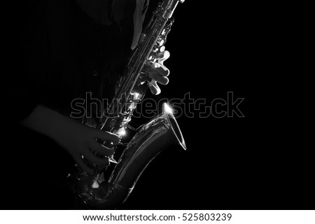 Saxophone Player hands Saxophonist playing jazz music. Alto sax musical instrument close up