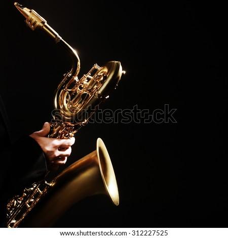 Saxophone player Jazz Music Instrument Baritone Sax isolated on black - stock photo