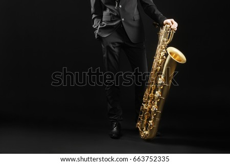 Saxophone player jazz musician. Saxophonist with baritone sax player