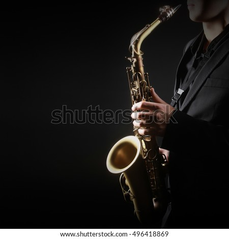 Saxophone Player Saxophonist playing jazz music with Sax alto