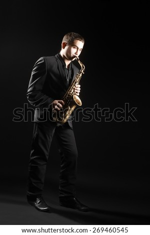 Saxophone player Saxophonist with alto Sax concert classical music - stock photo