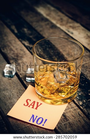 Say No ! with label on paper note. Glass of scotch whiskey  - stock photo