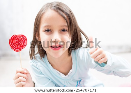 say ok for the sugar lollipop - stock photo