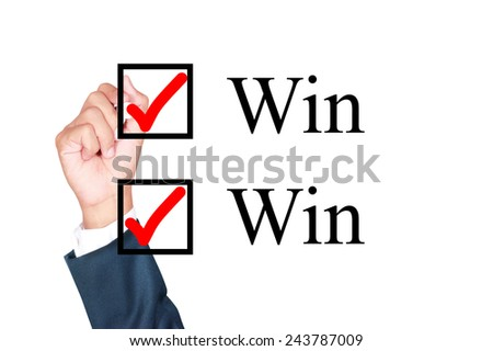 say win-win tick mark on check box by businessman draw on whiteboard white background - stock photo