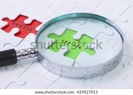 SAY YES and EXCUSE  puzzle with magnifier glass - stock photo