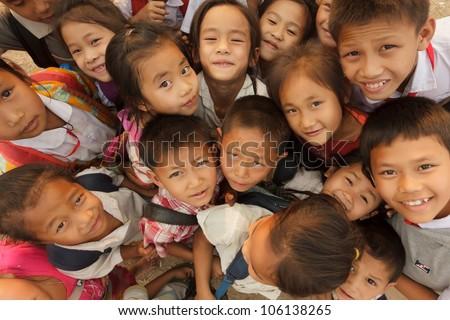 SAYABOURY - FEBRUARY 16: group of joyful unidentified kids posing during the Elefantasia festival on February 16, 2012 in Sayaboury, Laos - stock photo