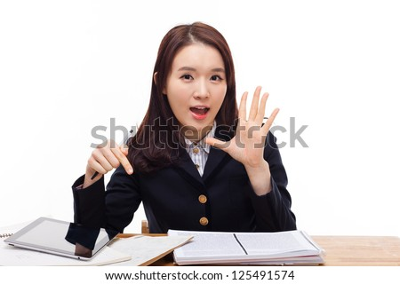 Saying young asian student on the desk  isolated on white background.