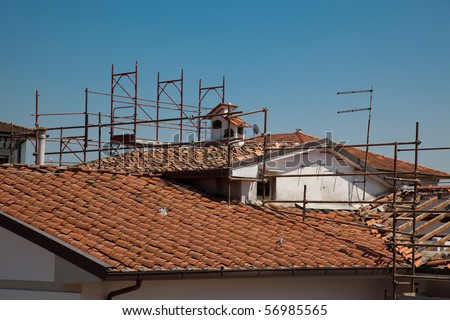 Scaffold and a the Broken Roof of an House