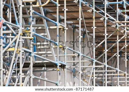 scaffolding at a building site of a concrete construction - stock photo