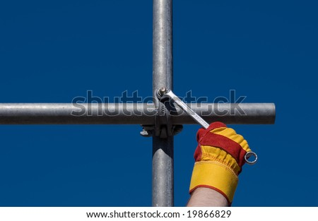scaffolding - background for construction and tools - stock photo
