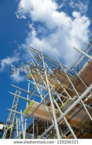 scaffolding construction with  blue sky - stock photo