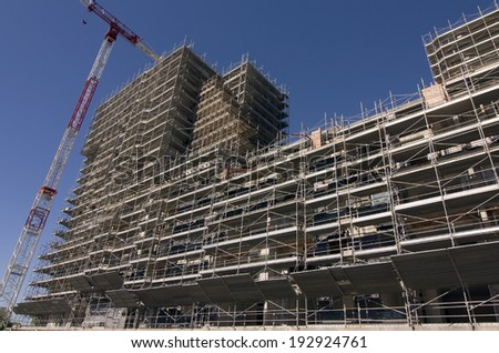Scaffolding on a construction site of a new building - stock photo