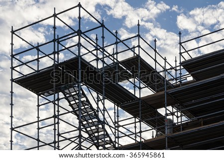 Scaffolding with staircase against sky