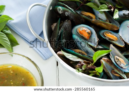scald mussel with spicy seafood sauce - stock photo