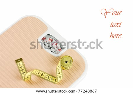 Scale and tape on white background - stock photo