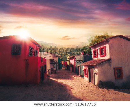 scale model of a mexican town at sunset - stock photo