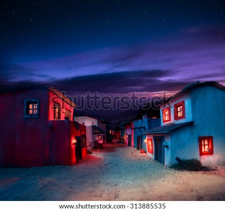scale model of a mexican town at twilight - stock photo
