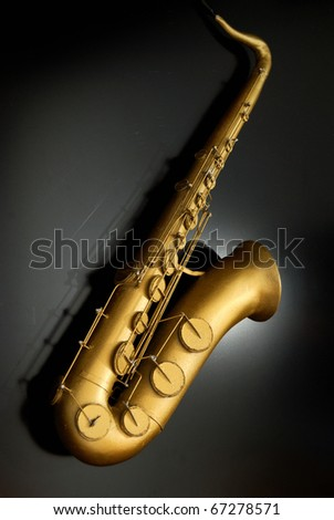 scale model saxophone on black