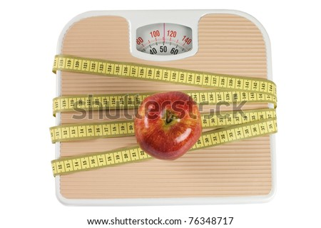 Scale, tape and apple on white - stock photo