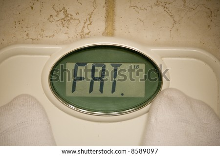 Scale telling individual that he is fat - stock photo