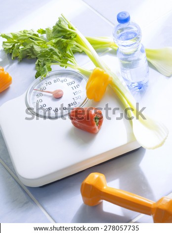 Scales and fruits and vegetables - stock photo