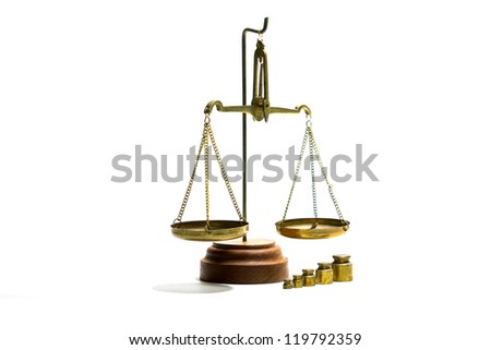 Scales balance and a set of weights on a white background - stock photo