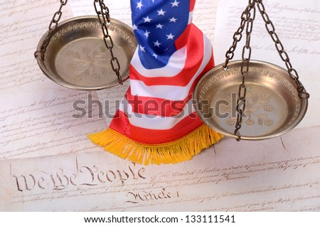 Scales of justice , American flag and US Constitution - stock photo