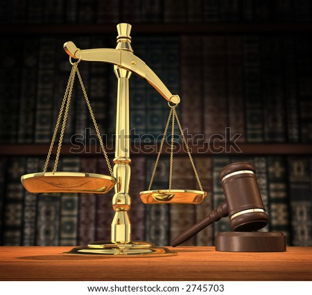 Scales of justice and gavel on desk with dark background that allows for copyspace. - stock photo