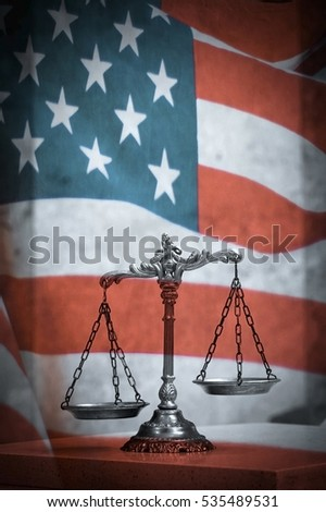 Scales of justice and united states of america flag