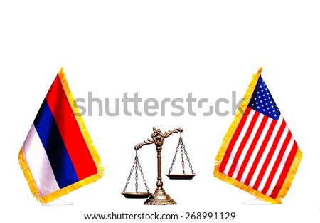 Scales of justice between American and Russian flag on the white background - stock photo
